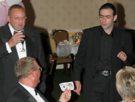 Paul performs close up magic for wedding guests
